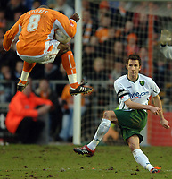 Photo: Paul Greenwood.<br />Blackpool v Norwich City. The FA Cup. 27/01/2007. Blackpool's Adrian Forbes (left) is hit by Adam Drury's clearance