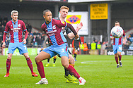 Cameron Borthwick-Jackson of Scunthorpe United (3) and Eoin Doyle of Bradford City (9) in action during the EFL Sky Bet League 1 match between Scunthorpe United and Bradford City at Glanford Park, Scunthorpe, England on 27 April 2019.
