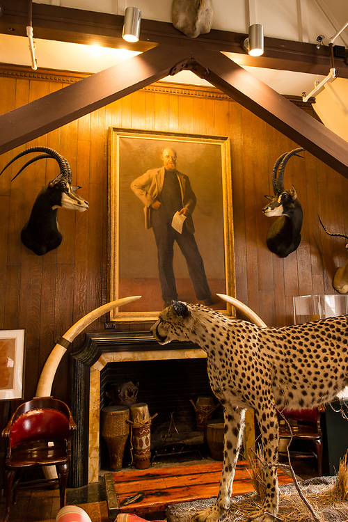 The gallery of The Explorers Club includes a portrait of Danish explorer Peter Freuchen by Robert Brackman over the mantel.