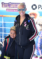 """Amber Rose and her son Sebastian Taylor Thomaz at the premiere of """"Hotel Transylvania 3: Summer Vacation"""" held at the Westwood Village Theatre in Los Angeles"""