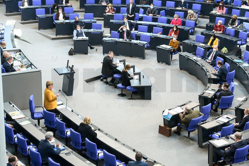 24 MAR 2021, BERLIN/GERMANY:<br /> Angela Merkel (L), CDU, Bundeskanzlerin, waehrend der Regierungsbefragung durch den Bundestag zur Bekaempfung der Corvid-19 Pandemie, Plenarsaal, Reichstagsgebaeude, Deutscher Bundestag<br /> IMAGE: 20210324-01-048<br /> KEYWORDS: Corona