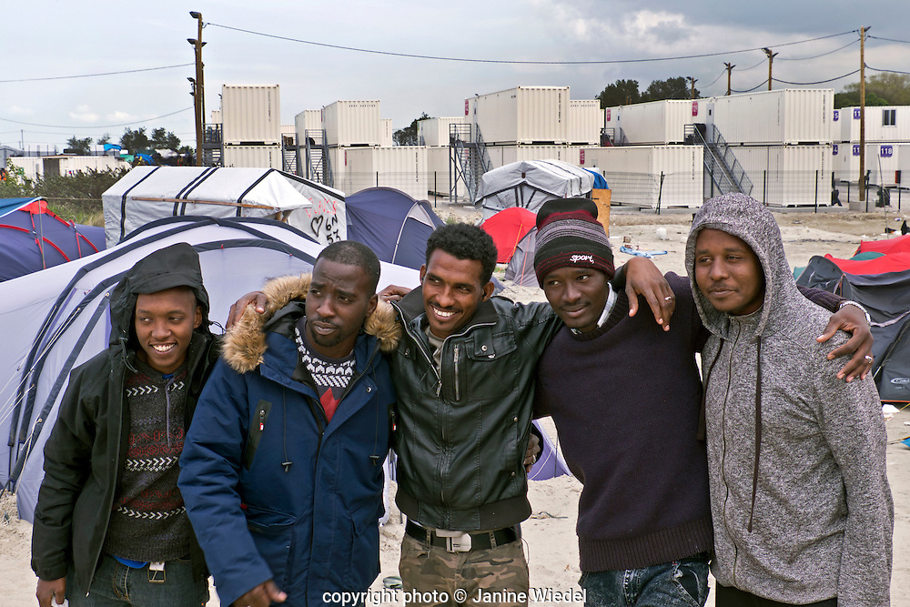 Group of young men from Africa living in The Calais Jungle Refugee and Migrant Camp in France