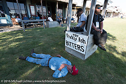 Cannonballers Jeff Lauritsen (having a nap), Rich Rau and Clint Funderburg after a great hosted dinner in historic downtown Dodge City, KS during the Motorcycle Cannonball Race of the Century. Stage-8 from Wichita, KS to Dodge City, KS. USA. Saturday September 17, 2016. Photography ©2016 Michael Lichter.