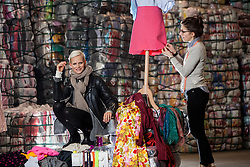 Model Anna Freemantle with student Hannah McKinnon, showing fashion students about upcycling clothes, at the UK's second largest textile recycling facility, Nathan's Wastesavers, in Denny.<br /> © Michael Schofield.