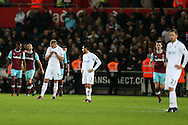 Swansea city players inc Leon Britton of captain (c)  look on dejected as they go 1-4 down. Premier league match, Swansea city v West Ham United at the Liberty Stadium in Swansea, South Wales on Boxing Day, Monday 26th December 2016.<br /> pic by  Andrew Orchard, Andrew Orchard sports photography.