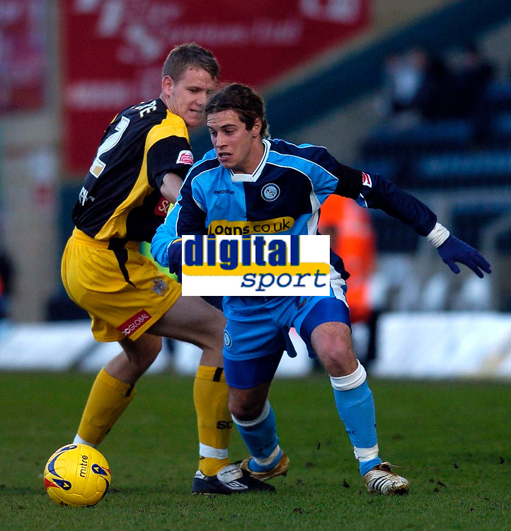 Photo: Alan Crowhurst.<br />Wycombe Wanderers v Stockport County. Coca Cola League 2. 28/01/2006. <br />Sergio Torres (R) attacks for Wycombe.