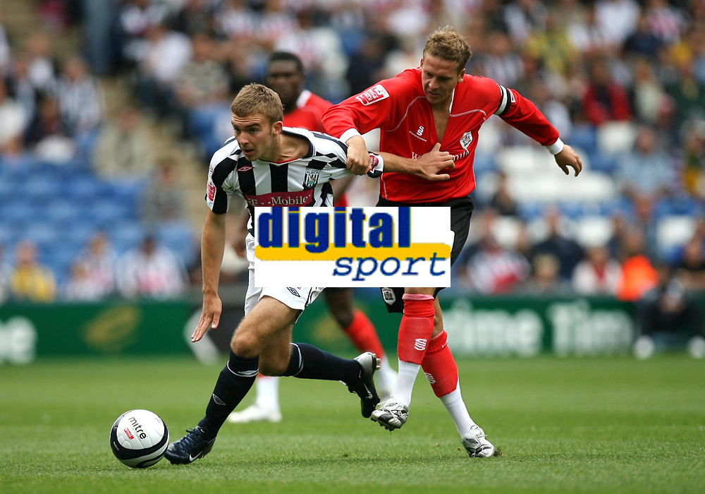 Photo: Rich Eaton.<br /> <br /> West Bromwich Albion v Barnsley. Coca Cola Championship. 01/09/2007. Barnsley's Brian Howard (r) holds james Morrison.