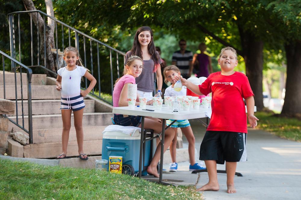 Children sell lemonade on a hot summer day in Boulder, Colorado.