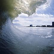 A wave breaks near Pelican Watch on the shore of Carolina Beach, NC.