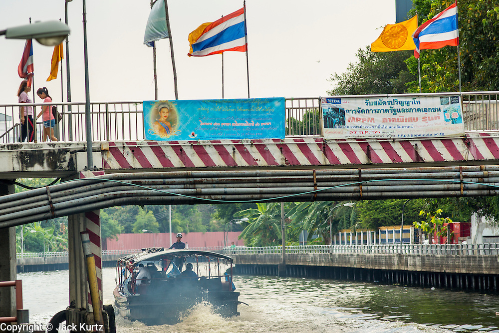 14 NOVEMBER 2012 - BANGKOK, THAILAND: A passenger boat leaves the Wat Sriboonreung Pier, the southern terminal of the Khlong Saen Saeb boat service. Bangkok used to be criss crossed by canals (called Khlongs in Thai) but most have been filled in and paved over. Khlong Saen Saeb is one of the few remaining khlongs in Bangkok with regular passenger boat service. Boats and ships play an important in daily life in Bangkok. Thousands of people commute to work daily on the Chao Phraya Express Boats and fast boats that ply Khlong Saen Saeb. Boats are used to haul commodities through the city to deep water ports for export.      PHOTO BY JACK KURTZ