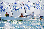 The culmination of 8 weeks of junior sailing for those sailing on Narragansett Bay happens at Race Week, the NBYA Junior Olympic Festival that incorporates Club 420s, Optis and Lasers into a three day sailing event. In the Optimist fleet, no competition is lost among these junior sailors age 8-13.  The breeze had picked up as wind howled across Conanicut Island to deliver gusts around 15 knots for these sailors in the middle of the East Passage.