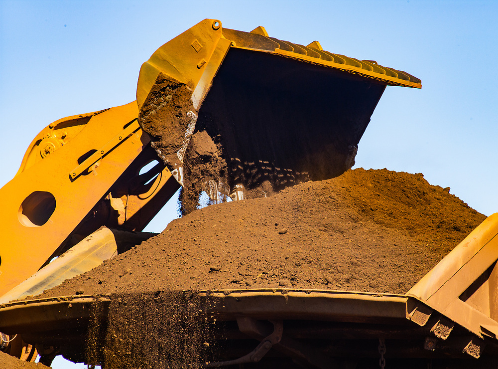 Iron ore is loaded onto a Haulage truck at a mine site in the Pilbara region in Western Australia