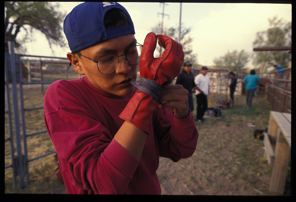 Cuyler Frank(16).  Bull riding practice at A-M Arena, $7 per ride.  Shiprock, NM  1993