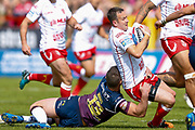 Leeds Rhinos second row Stevie Ward (13) tackles Hull Kingston Rovers stand off Danny McGuire (7)  during the Betfred Super League match between Hull Kingston Rovers and Leeds Rhinos at the Lightstream Stadium, Hull, United Kingdom on 29 April 2018. Picture by Simon Davies.