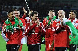 Joe Allen share a joke with David Cotterill - Mandatory byline: Dougie Allward/JMP - 07966 386802 - 13/10/2015 - FOOTBALL - Cardiff City Stadium - Cardiff, Wales - Wales v Andorra - European Qualifier 2016 - Group B