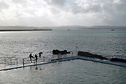 Boys playing at Shoalstone Pool in Brixham on 27 July 2017, Devon, United Kingdom. Shoalstone Pool is a sea-water swimming pool or lido on Shoalstone Beach, Brixham, Devon. The pool is the English Rivieras only open air 50m sea-water swimming pool
