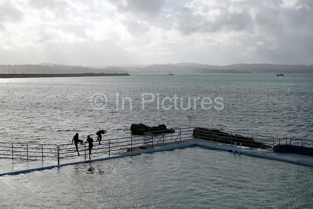 Boys playing at Shoalstone Pool in Brixham on 27 July 2017, Devon, United Kingdom. Shoalstone Pool is a sea-water swimming pool or lido on Shoalstone Beach, Brixham, Devon. The pool is the English Rivieras only open air 50m sea-water swimming pool