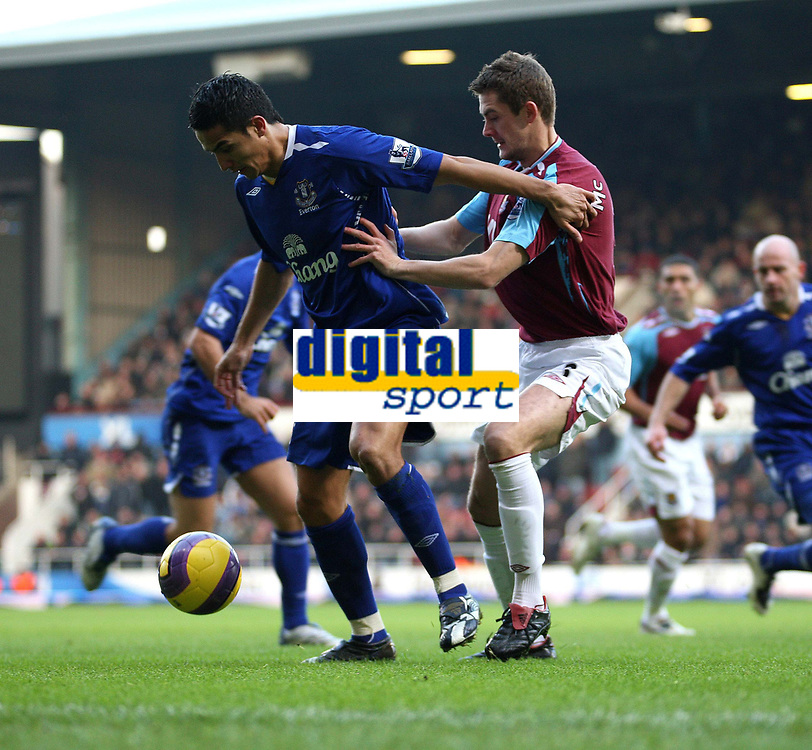 Photo: Karyn Haddon/Sportsbeat Images.<br />West Ham United v Everton. The FA Barclays Premiership. 15/12/2007.<br />Tim Cahill for Everton battles for the ball with West Ham's George McCartney