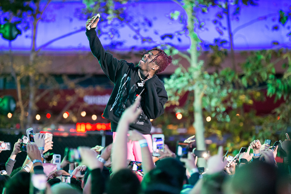 Lil Uzi Vert takes a selfie with a fans phone during a performance.