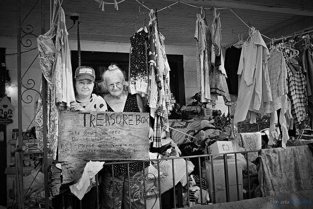 Loye Price, 80, and her daughter Crystal Price, operate a small clothing bank on their front porch at 1317 Lexington Ave. They take donations at their sidewalk with blue plastic bins. They say they seem to offer assistnace to help homeless men and young mothers the most.<br /> <br /> <br /> Treasure Box (free stuff)<br /> Take what you need<br /> Donate what you don't<br /> Please don't leave a mess<br /> and replace lid back on bins<br /> thanks!<br /> <br /> Photographed, Wednesday, June 2, 2018, in Greensboro, N.C. JERRY WOLFORD / Perfecta Visuals