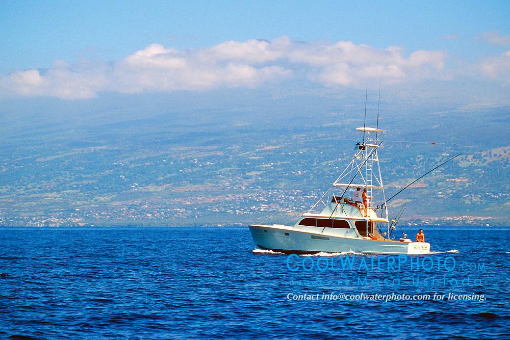 sport fishing boat, trolling in front of Hualalai mountain, Kona, Big Island, Hawaii, USA, Pacific Ocean