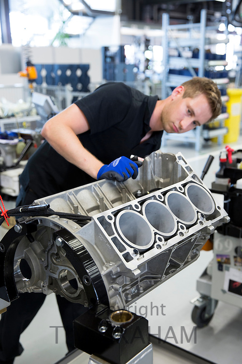 Mercedes-AMG engine production factory in Affalterbach, Germany - engineer checks engine block of 6.3 litre V8 engine