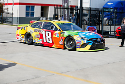 November 2, 2018 - Fort Worth, TX, U.S. - FORT WORTH, TX - NOVEMBER 02: Monster Energy NASCAR Cup Series driver Kyle Busch (18) drives through the garage area during practice for the AAA Texas 500 on November 02, 2018 at the Texas Motor Speedway in Fort Worth, Texas. (Photo by Matthew Pearce/Icon Sportswire) (Credit Image: © Matthew Pearce/Icon SMI via ZUMA Press)