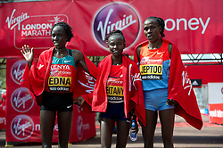 © London News Pictures. 22/04/2012. London, UK.  (L to R) Edna Kiplagat of Kenya (2nd place), Mary Keitany of Kenya (1st place) and Priscah Jeptoo of Kenya (3rd place) pose after the Virgin London Marathon 2012 on April 22, 2012 in London, England. Photo credit : Ben Cawthra /LNP