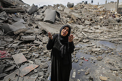 March 26, 2019 - Gaza City, The Gaza Strip - A Palestinian woman stand at the rubble of her house  in Gaza city after Israeli warplanes carried out dozens of airstrikes across the Gaza strip,The Israeli escalation came after a Gaza rocket struck an Israeli house. (Credit Image: © Abed Alrahman Alkahlout/Quds Net News via ZUMA Wire)
