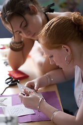 Young women working together in a parenting class; run by the Aspire Training Scheme for young mothers and mothers to be,
