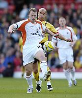 Photo: Jonathan Butler.<br /> Watford v Blackpool. Coca Cola Championship. 29/09/2007.<br /> Michael Flynn of Blackpool is held back by Gavin Mahon of Watford.