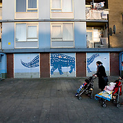 "Nederland Utrecht 31 januari 2009 20090131 Foto: David Rozing ..Serie vogelaarwijk Kanaleneiland .Reportage documentary on deprived area / projects "" Kanaleneiland "" This area is on a list with projects which need help of the government because of degradation in the area etc.straatbeeld, 2 moslima's met kindren in kinderwagens voor appartementen.2 muslim women goning out for a stroll..project, suburb, suburbian, problem. Neighboorhood, neighboorhoods, district, city, problems, multicultural, immigrant, immigrants, cultural diversity, daily life.Foto: David Rozing"