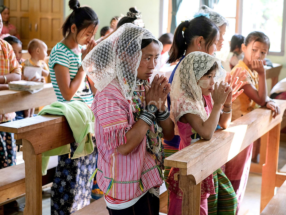 Easter Sunday service at St Michaelss church in the ethnic Kayaw village of Yo Co Pra on 27th March 2016 in Kayah State, Myanmar. In the past most people residing in Kayah State were traditional spirit worshippers, but significant numbers have converted to Christianity, especially  Baptists or Catholics