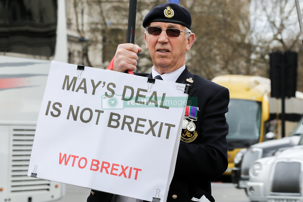 March 27, 2019 - London, UK, United Kingdom - A pro-Brexit demonstrator is seen holding a placards that says May's deal is not Brexit during the protest outside the Houses of Parliament..Theresa May told the backbench Tory MPs this evening that she will stand down if they back her EU withdrawal deal. (Credit Image: © Dinendra Haria/SOPA Images via ZUMA Wire)