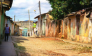 The instantly recognizable island of Cuba is one of the most insular islands in the Caribbean. Che Guevara murals and dilapidated American Buicks, old men slapping down dominoes and strumming guitars, queues outside ration shops and communist cadres smoking chunky Montecristos and smiley kids playing in the open doorways of their humble homes. Cuba has a way of going against the grain. It's all part of its historical make-up, part of its dynamism, part of its intrinsic beauty. But In contrast to the celebrated and well-walked streets of Old Havana, I wander along the famous 'Malecon' in search of something different and intriguing. I eventually stumble across the 'Necropolis Cristobal Colon' which contrasts interestingly with the charismatic backstreets of 'Old Havana' and adds another chapter to the this particular feature. A massive graveyard laid out like a miniature city of the dead. After entering through the northern gateway and  a short walk amongst bronze statues, octagonal chapels and impressive marble tombstones I notice a small building at the back crudely labelled 'Edificio 1' (Building 1) which stands abandoned and alone, provoking investigation.