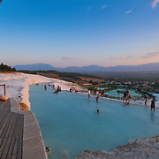 Tourists swim in travertine pools in Pamukkale, Turkey