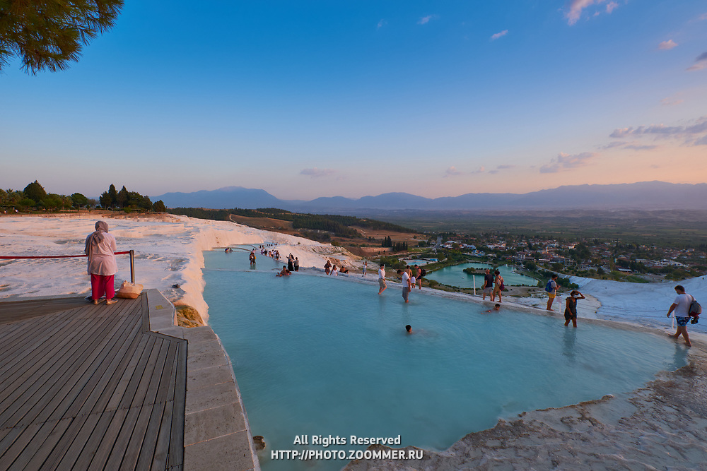 Tourists swim in travertine pools in Pamukkale, Turkey