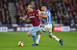 West Ham United's Marko Arnautovic (left) and Huddersfield Town's Christopher Schindler battle for the ball during the Premier League match at the John Smith's Stadium, Huddersfield.