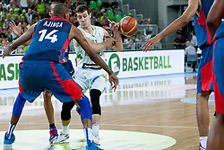 Goran Dragic of Slovenia and Alexis Ajinca of France during last friendly match before Eurobasket 2013 between National teams of Slovenia and France on August 31, 2013 in SRC Stozice, Ljubljana, Slovenia. (Photo by Urban Urbanc / Sportida.com)