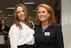 © Licensed to London News Pictures. 11/09/2018. London, UK.  Mel C with Sarah Duchess of York at the 14th Annual BGC Charity Day held on the trading floor of BGC Partners in Canary Wharf, to raise money for charitable causes in commemoration of BGC's 658 colleagues and the 61 Eurobrokers employees lost on 9/11.  Photo credit: Vickie Flores/LNP