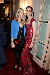 Left to right, POPPY DELEVINGNE and ERIN O'CONNOR at a private view of fashion art by David Downton as in-house artist at Caridge's , held at Claridge's Hotel, London on 13th September 2013.