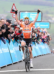 Boels-Dolmans' Megan Guarnier celebrates as she crosses the line to win the stage during day two of the ASDA Women's Tour de Yorkshire from Barnsley to Ilkley.