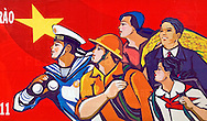 Big propaganda poster representing vietnamese characteres from profile. They look in the same direction like a united people self-confident in the future. Region of Nha Trang, Khanh Hoa area, Viet Nam, Asia.