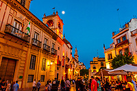A small square at the intersection of Calle de Santa Maria la Blanca and Calle Ximenez de Enciso, in the Santa Cruz neighborhood of the old city, Seville, Andalusia, Spain.