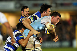 Mark Wilson of Newcastle Falcons is tackled by David Sisi and Gavin Henson of Bath Rugby - Photo mandatory by-line: Patrick Khachfe/JMP - Mobile: 07966 386802 15/11/2014 - SPORT - RUGBY UNION - Bath - Recreation Ground - Bath Rugby v Newcastle Falcons - Aviva Premiership