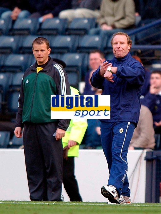 Photo. Richard Lane<br />Scotland v Iceland. Euro 2004 Qualifying Match at Hampden Park. 29/03/2003.<br />Berti Vogts complains to the referee about the added time at the end of the second half.