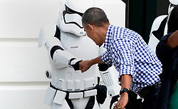 President Barack Obama (R) gives a fist bump to a storm trooper during the White House Easter Egg Roll on the South Lawn of the White House March 28, 2015 in Washington, DC, USA. Photo by Olivier Douliery/Pool/ABACAPRESS.COM  | 540731_003 Washington Etats-Unis United States
