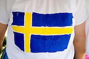 Hand painted flag of Sweden on t-shirt. Svenskarnas Dag Swedish Heritage Day Minnehaha Park Minneapolis Minnesota USA