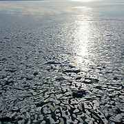 Cambridge Bay, viewed from a floa plane,  ice holding on into late July, Nunavut, Canada.