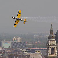 Airplane flies over the city during an air show above river Danube crossing central Budapest, Hungary on May 01, 2013. ATTILA VOLGYI